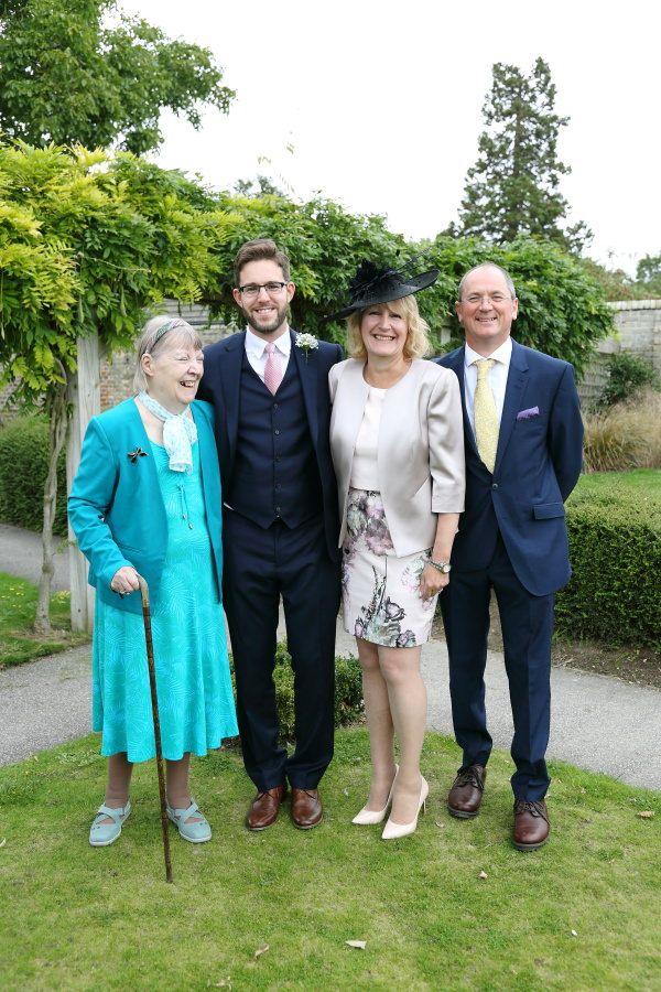 fun honest family group shot at saffron walden wedding