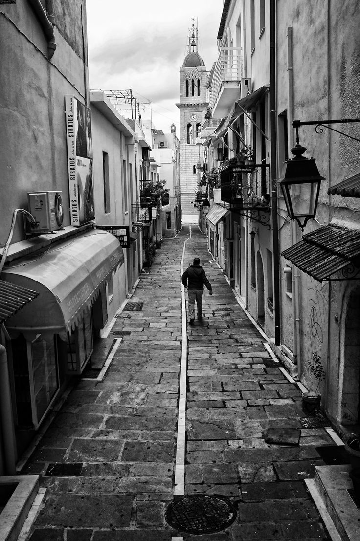 This is another photo I shot during my last Street Hunt. At the bottom of the path is a church. The Mitropolis of Rethymno. This is a very narrow path that isn't accessible via automobiles. To access it you have to climb down some stairs. I was walking when I saw this man walk down the stairs and only thought of taking his photo at the last minute. I am happy I did. Snap! If you want to see how I took the photo, you can view the relevant clip on the official Street Hunters YouTube Channel at…