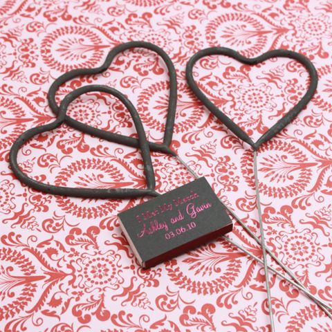 By pairing some heart shaped sparklers with a book of matches, you can hand out an elegant wedding favor your guests can actually use.