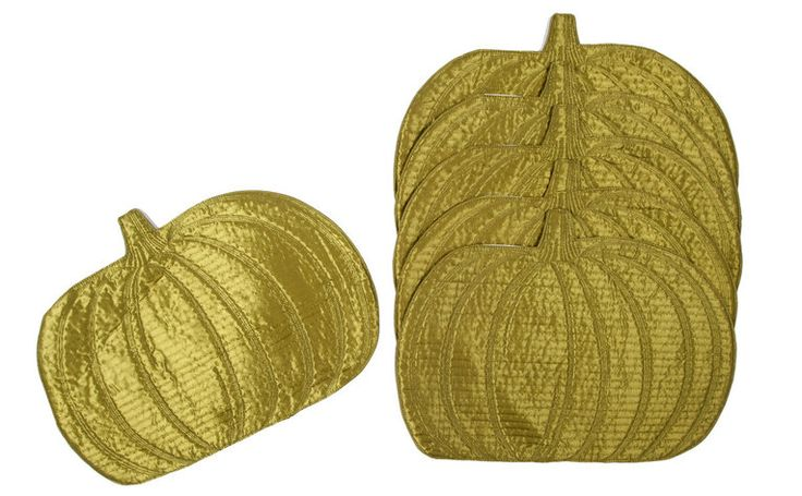 The 6 piece Green Pumpkin dining place mat is perfect for every day use or for the fall holiday seasons. Each one has bright green shiny colors with a pumpkin detail stitching and padded for dining table protection or insulating hot/cold cookware. Great for protecting the table from dropped food and serving place mat.