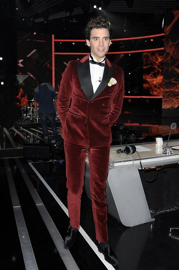 Mika in a Valentino velvet red suit
