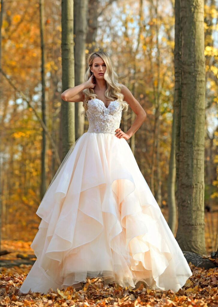 Marisa Bridals 180 strapless tulle ball gown withe lace bodice and embellished details throughout the bodice with a low back and horsehair hem tulle skirt.