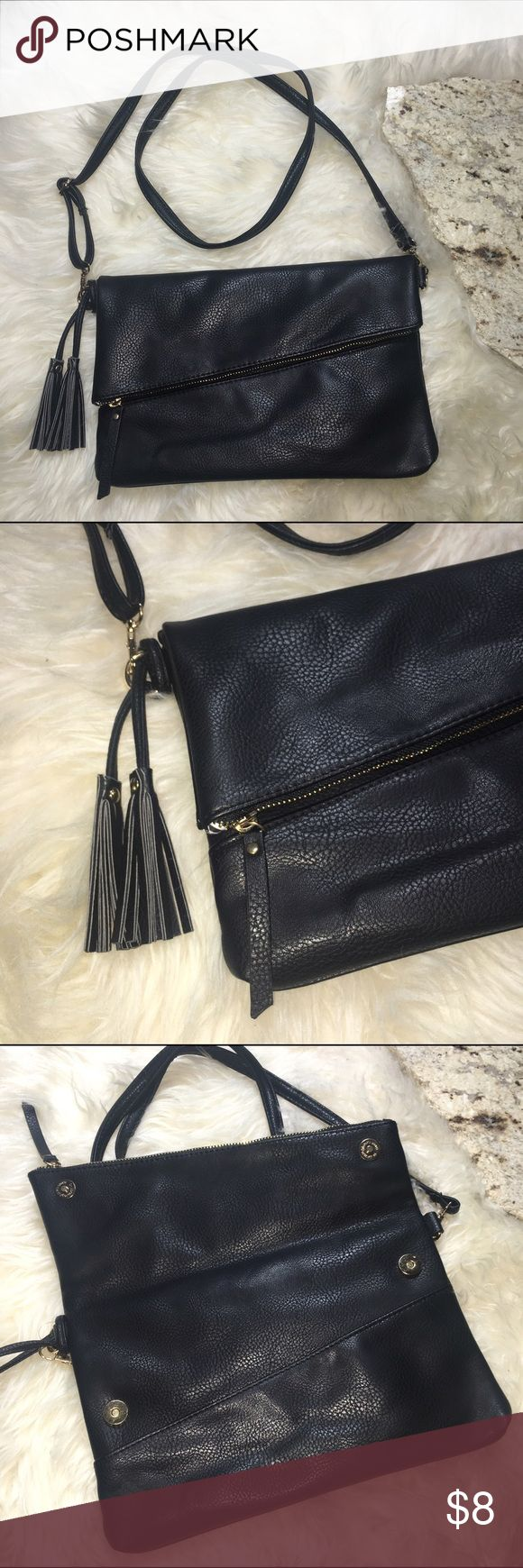 """Black Ei8th by Under One Sky Fold Over Purse Black synthetic leather fold over purse. Excellent pre owned condition no rips or stains. Gold hardware removable and/or adjustable strap with tassel detail. Measures: 8"""" X 12"""" Ei8th by Under One Sky Bags"""