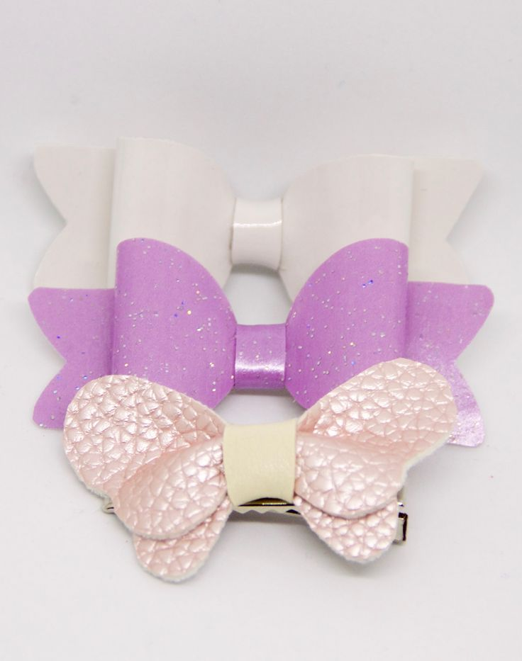 """Gorgeous Sparkly set of 3 Bows  In this set you will receive:   Vinyl Shiny White Medium Size Bow  Sparkly Violet Fabric Medium Size Bow  Pearl Pink Leather Medium Size Butterfly Bow  All my bows are designed and hand crafted by me personally and are made of great quality materials.   The bow is fitted with an alligator clip that measures 1.77"""", perfect for any type of hair."""