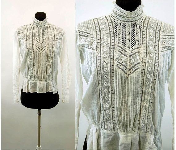 This is a lovely Edwardian blouse form the 1910s. Its made a sheer batiste fabric which is highly embellished with lace inserts, pin tucking and