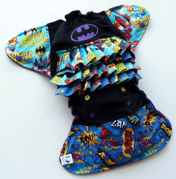 Girl's super-hero minky one-size ruffled pocket cloth nappy by Tweedlebee and Tweedlebum on Etsy.