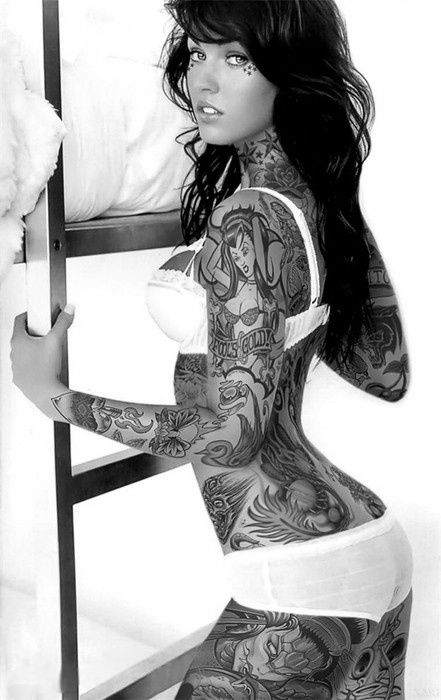 Could never have this many tats but this chick is hot with them lol. She looks like Megan Fox.