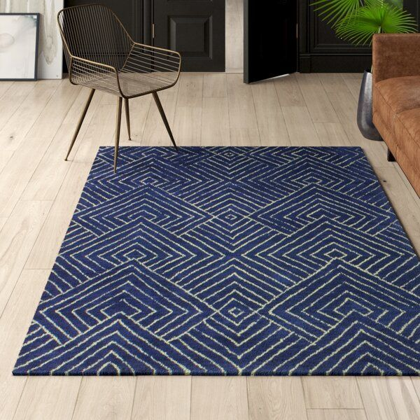 No Matter Which Room You Re Decorating An Area Rug Brings A Pop Of Pattern Or A Dash Of Color This Piece Sports An Ove Navy Area Rug Area Rugs Blue Area