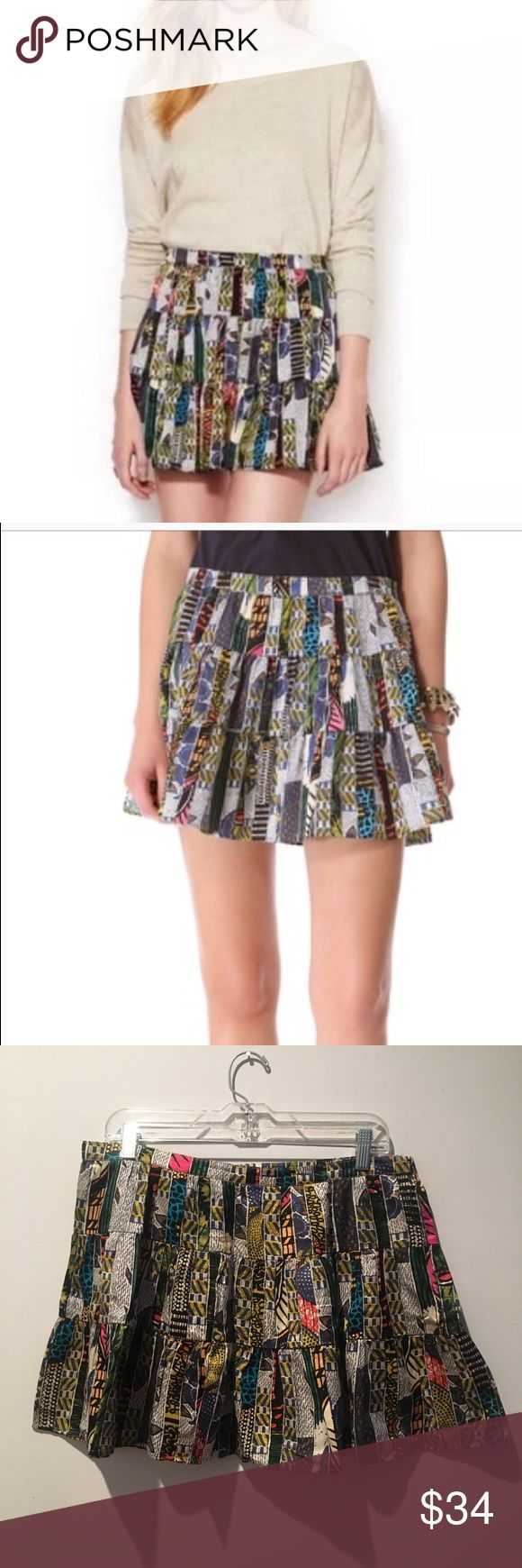 Burning Torch Ashanti Tiered Skirt - Anthropologie Baby it's cold outside but soon our legs will want to make an appearance again!  This short, tiered skirt gains a playful patchwork look from a colorful, batik-inspired print. Hidden side zip. Unlined.  Fabric: Voile. 65% cotton/35% silk. Imported  MEASUREMENTS Length: 17in across and 15in long. Size: Large  This skirt is worn once. It wasn't the right size for me and I made it work only once Burning Torch Skirts Mini
