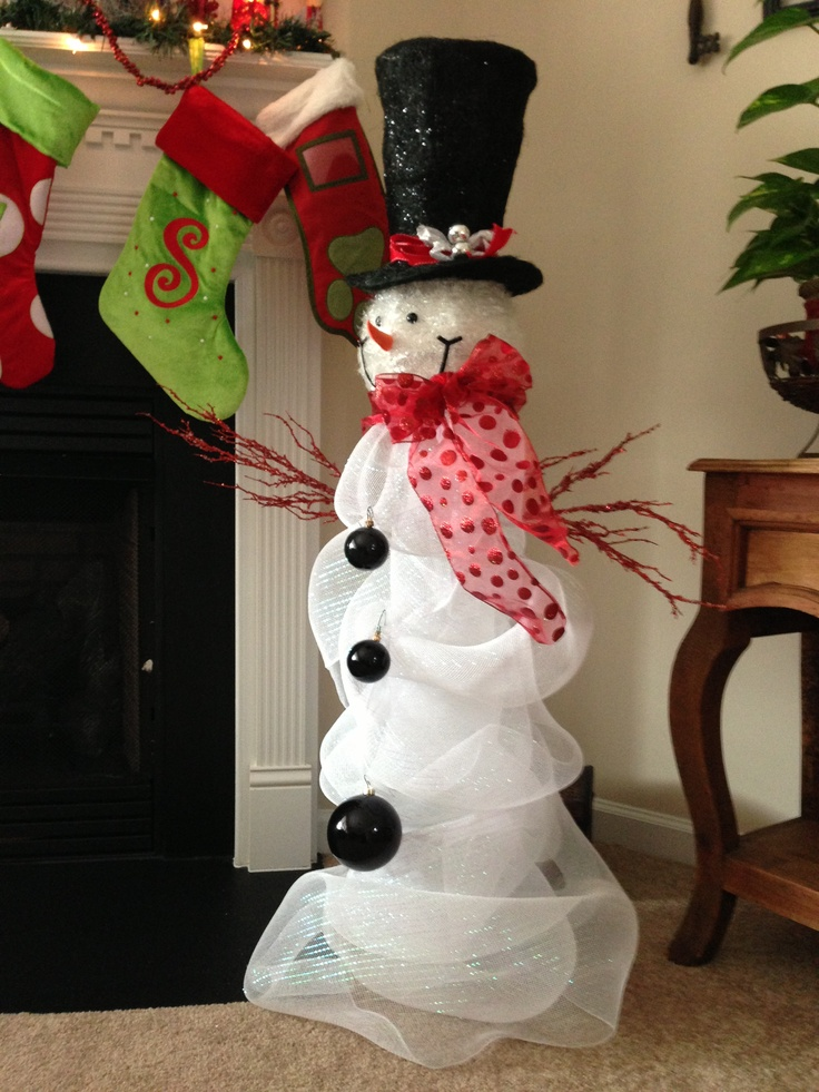 ~Cracker Barrel snowman head with deco mesh wrapped around large glass vase. Ornaments for buttons and decorative twigs from Michaels attached with wire for arms. Took about an hour. I think it turned out ok. ?!? *
