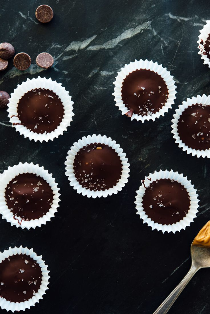 Delicious homemade mini peanut butter cups—this recipe is so easy and only requires 3 ingredients! (Ok, 4 if you want to top them with flaky sea salt, which I recommend.) #Halloween