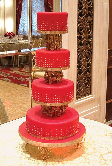 RED WEDDING CAKE WITH GOLD GILDED DOTS -Cake by Elizabeth Hodes Custom Cakes, Manhattan $15 per slice, 100 servings