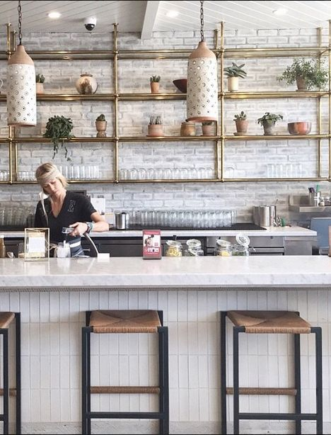 All vegan restaurant with beautiful decor using brass and white brick #losangeles #california