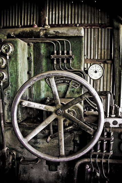 Industrial Secondary image, a wheel that appears attached to an engine of sorts - most likely a train.