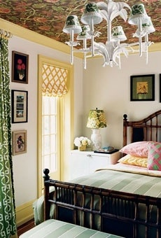 White, yellow and green bedroom with black accent. Mix of patterns!