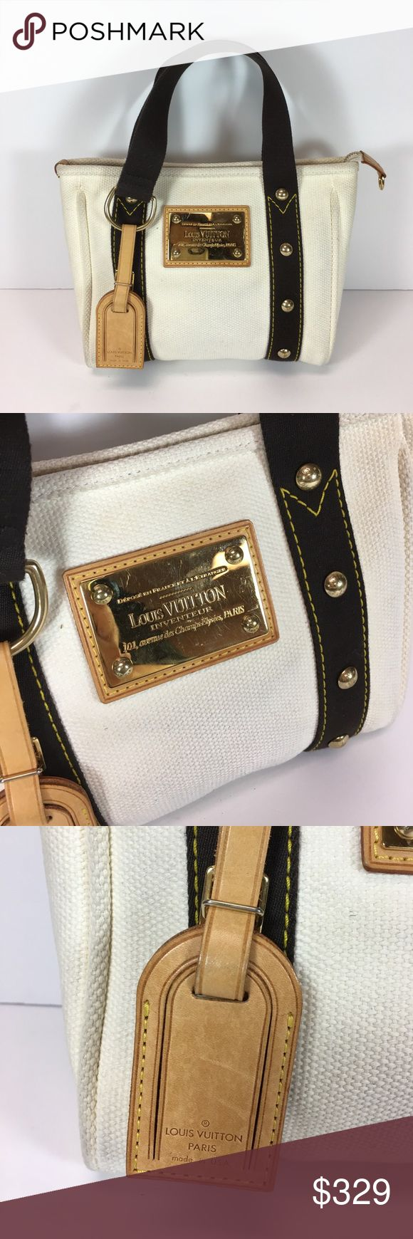 Louis Vuitton Canvas Antigua Canada Tote Cream canvas tote with dark brown handles, gold hardware and tan trim. In good used condition. Interior is very clean with no rips, exterior shows slight darkening on bottom. Louis Vuitton Bags Totes