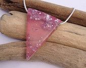 Clear Persian pink eco-resin triangle icicle drop with silver foil and black swirl detail, on sterling silver snake chain.