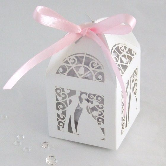 Delicate laser cut lantern style favour box. This beautiful box is available in either white or ivory and will fit perfectly into any celebration. Shipped flat for easy self assembly. 5cm cube with additional 4cm height to the top. Ribbon not supplied but is available to purchase. Allow 1/3 metre per box or simply use our self-adhesive bows after securing with curling ribbon.