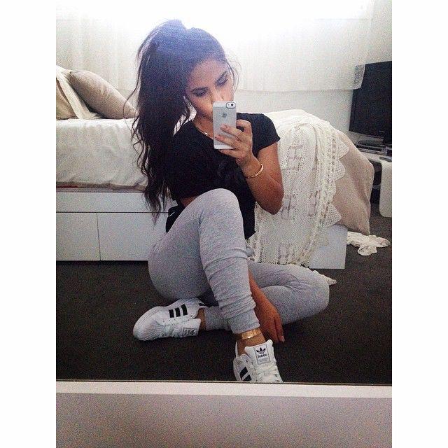lazy messy ponytail + plain black tee + sweatpants + adidas