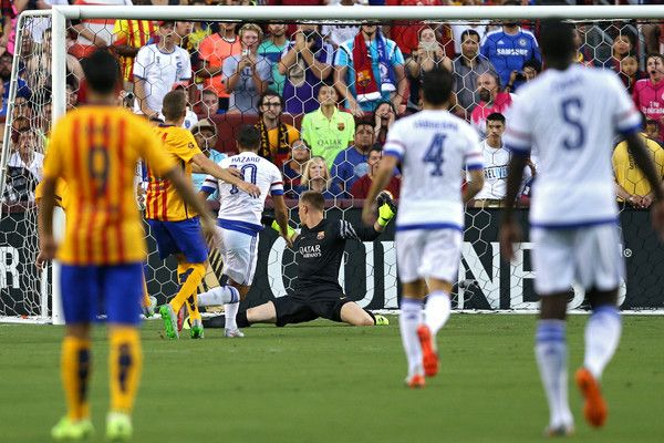 Eden Hazard #10 of Chelsea scores on goalkeeper Marc Andre ter Stegen #1 of Barcelona in the first half during the International Champions Cup North America at FedExField on July 28, 2015 in Landover, Maryland.