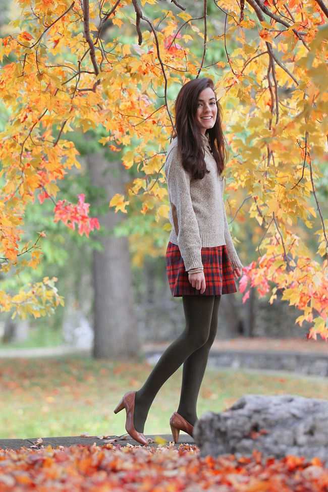 autumn: wool sweater with elbow patches, plaid skirt, tights and cognac heels.