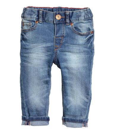 5-pocket jeans in washed stretch denim. Adjustable elasticized waistband, fly with snap fastener, and slim legs.