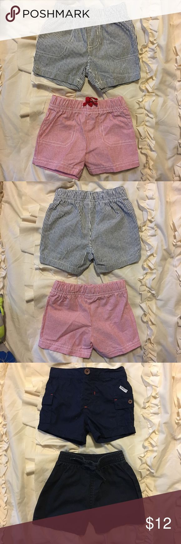 Four Pair of Baby Boy Shorts -- Sizes 3-6 Months Bundle of Baby Boy Shorts -- First and Second Picture -- Top Pair -- Carter's Blue Striped Shorts with Pockets -- Work Once -- Great Condition! Size 6 Months -- Bottom Pair -- Carter's Red Striped Shorts with Pockets and Tie in the Front -- Brand New -- Without Tags -- Never Worn! -- Size 6 Months -- Third and Fourth picture -- Top Pair Carter's Blue Shorts with Pockets -- Worn a Few Times -- Great Condition! Red Stitching Detail. -- Size 3…