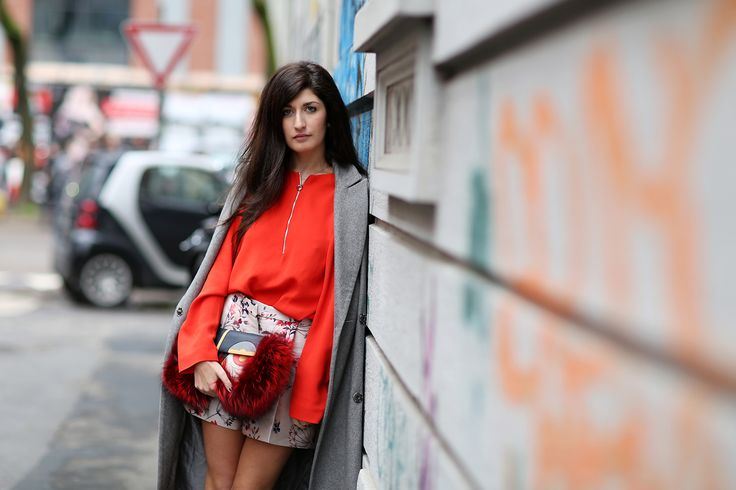 Tuck a tomato-red blouse into patterned mini shorts for a high-contrast, high-impact ensemble.