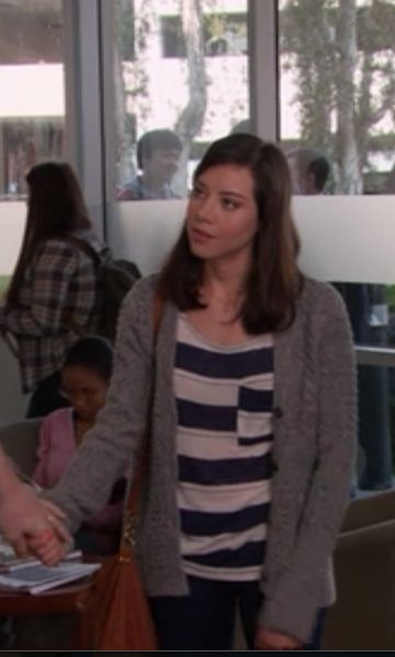 April Ludgate Outfits Both the navy striped top and the grey cardigan were from urban outfitters.