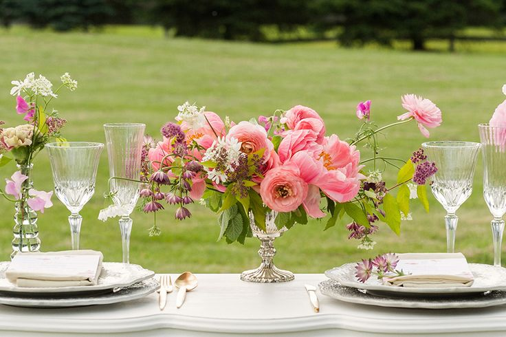 pretty centerpiece in soft pinks and corals, featured on Strictly weddings blog Vintage Italian Summer Wedding