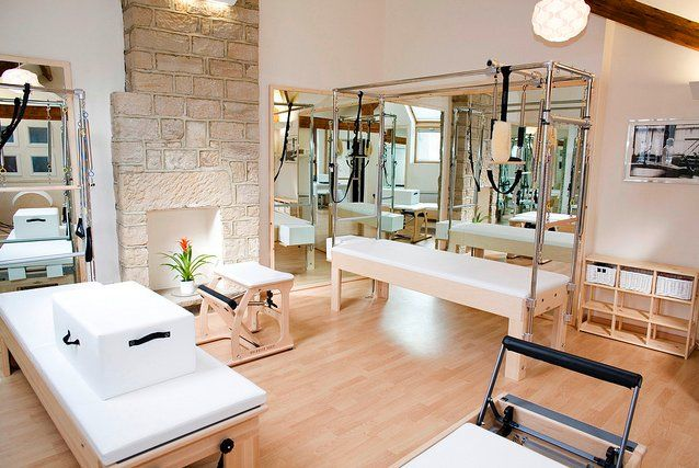 Designing your rooms using pilates equipment can be innovative, exciting and frightening. This kind of equipment does not look like any home gym, or exercise equipment.    In this picture:    The chair  The cadillac  The reformer  The barrel  Mirrors