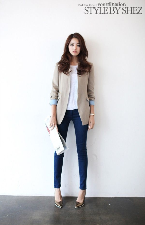 Shop this look on Lookastic:  http://lookastic.com/women/looks/brown-pumps-navy-skinny-jeans-white-sleeveless-top-beige-blazer/5988  — Brown Leather Pumps  — Navy Skinny Jeans  — White Sleeveless Top  — Beige Blazer