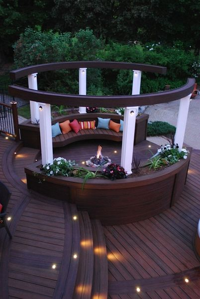 This circular seating area designed by paul lafrance for Circular garden decking