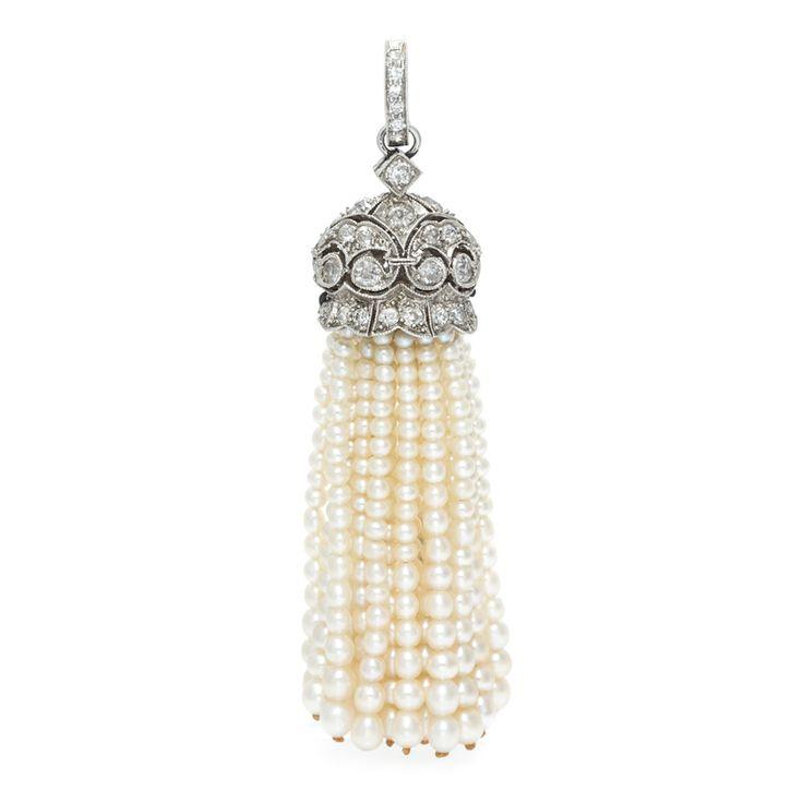 Lot 106: A Platinum, Diamond and Seed Pearl Tassel Pendant