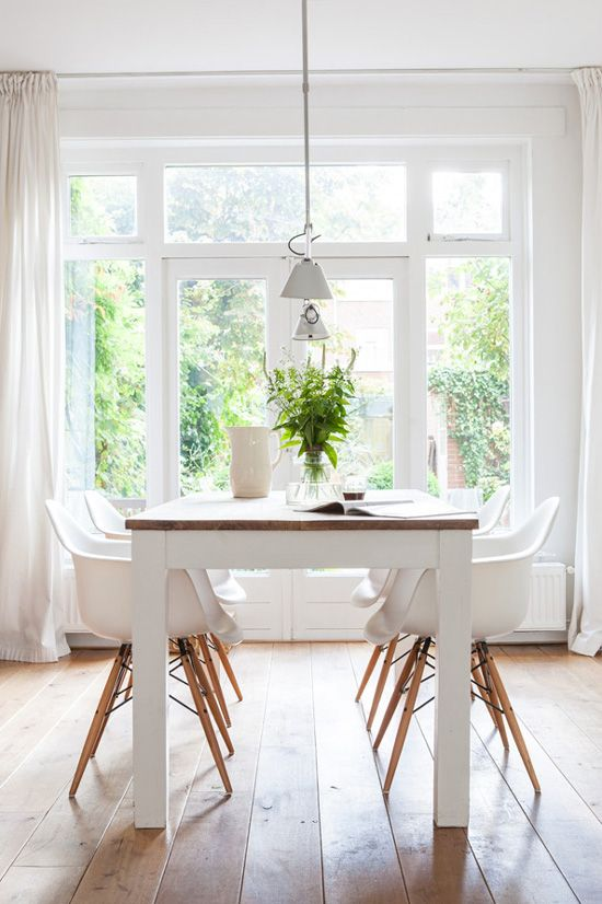 Clean, pretty white dining room