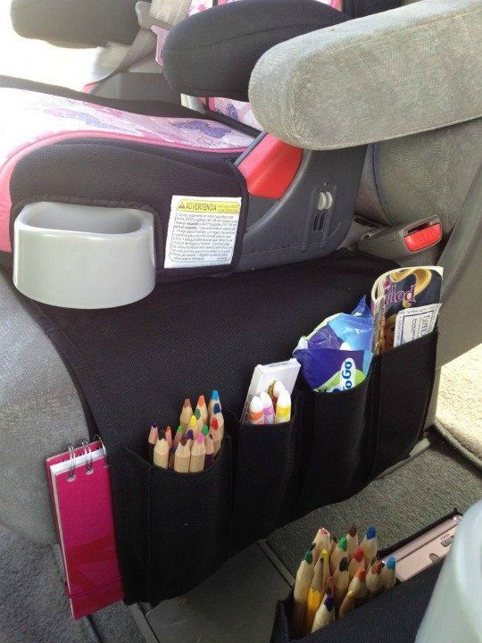 We've tried many different ways to organize the back seat of our car.  With young ones in car seats, it's a struggle to keep their books, toys, snacks, and other items neat and tidy.