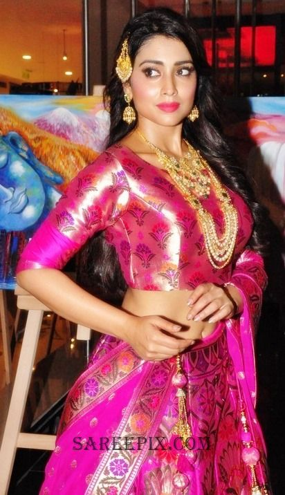 Ageless beauty Shriya Saran in pink lehenga at Wedding Vow Fashion Show. Shriya Saran lehenga photos.