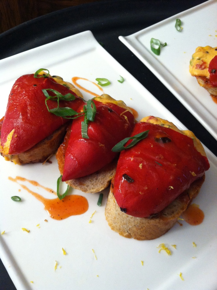 Black bean, roasted corn, and goat cheese stuffed piquillo peppers with anchiote sauce.