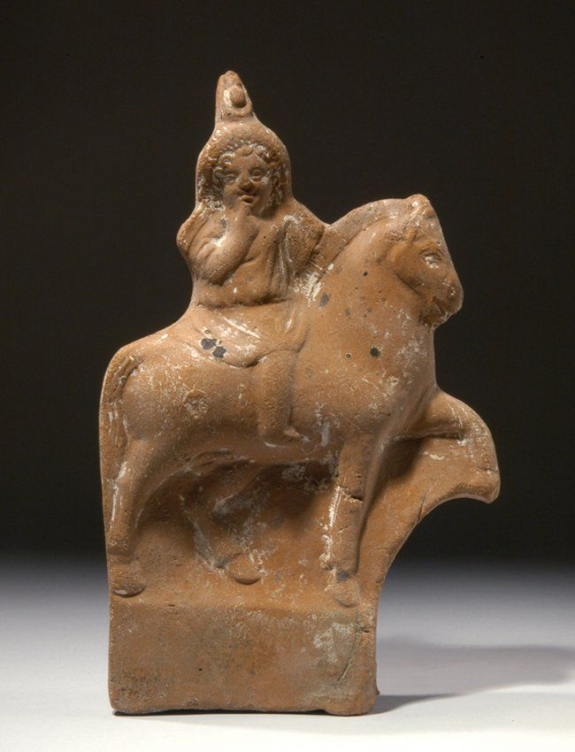 Roman Egyptian terracotta figure of Harpokrates on horseback, 1st century B.C.-1st century A.D. Wearing long tunic and double crown of Upper and Lower Egypt, forefinger to his mouth, 16.4 cm high. Private collection