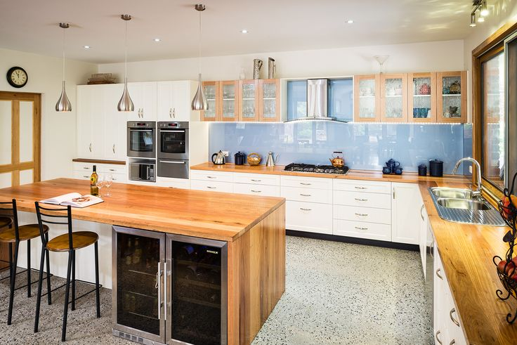 "Contemporary Country Living at it's finest. Combining new and old can be tricky but this modern country kitchen is an example of how to do it right.  Recycled Messmate timber benchtops, polished aggregate floors and pastel glass splashbacks are teamed with Albedor's ""Sheree"" profile doors with added lines. A perfect blend wouldn't you say?  J E Brierley Joiners & Cabinet Makers For more information please visit our website at   www.albedor.com.au"
