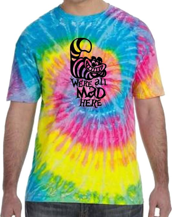 Disney Cheshire Cat tie dye shirt/ Alice In Wonderland tie dye T-shirt/ we're all mad here matching family vacation tie dye shirts featuring the smiling Cheshire Cat on your choice of cool tie dye shirt colors.