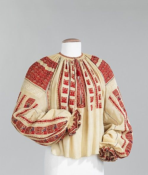 Blouse. 1875-1900, Romania. Cotton, silk. The disposition of embroidery on this blouse is distinctly Romanian. Dense bands of geometric motifs over the shoulders and vertical bands below alternating with drawnwork bands are quintessentially Romanian Source: Met Museum