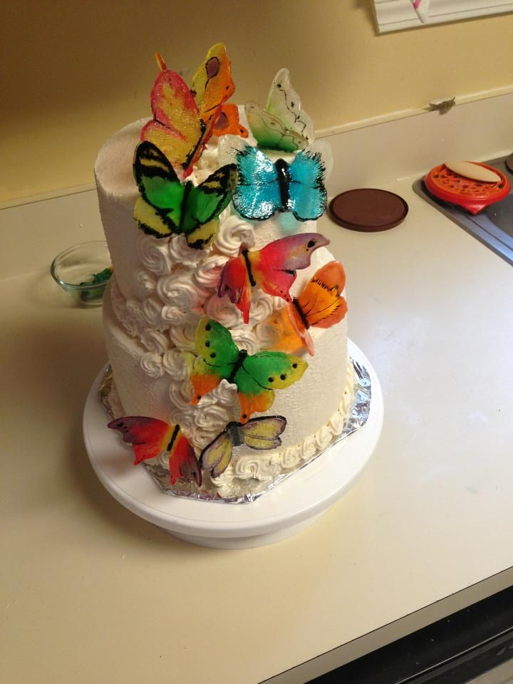 My mom did this for a coworker for her birthday. The butterflies are just crushed Jolly Ranchers and other candies like that put into butter...