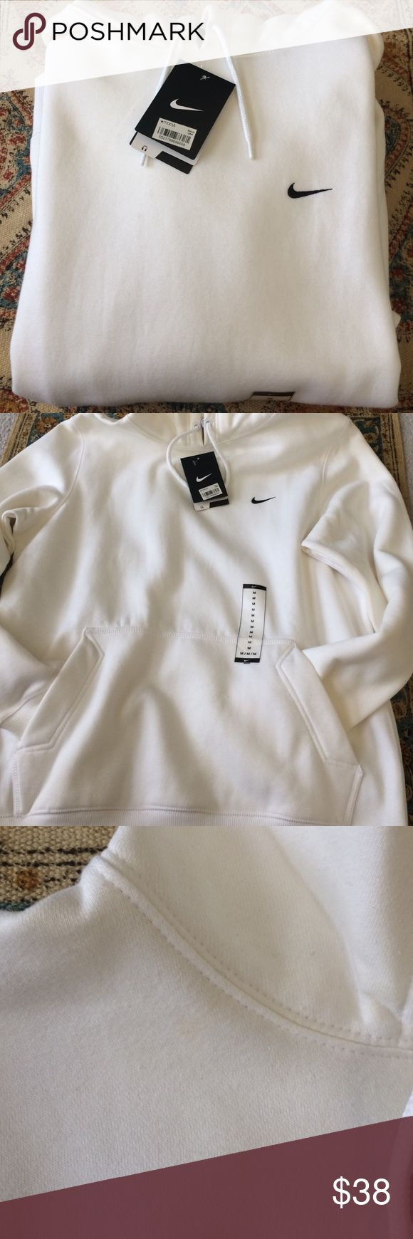 NWT WHITE NIKE HOODIE NWT, never been worn. This a men's hoodie size medium, but I wear them. Super soft and has an earphone hole. Oversized and perfect for that sport chic look. There are two stains on it, but they are very light and I haven't run it through the washer. I think it's dust from when I bought it. NO TRADES❌ ASK QUESTIONS OFFERS CONSIDERED ✨ When made through button. Check out my closet for other awesome items!  Nike Tops Sweatshirts & Hoodies