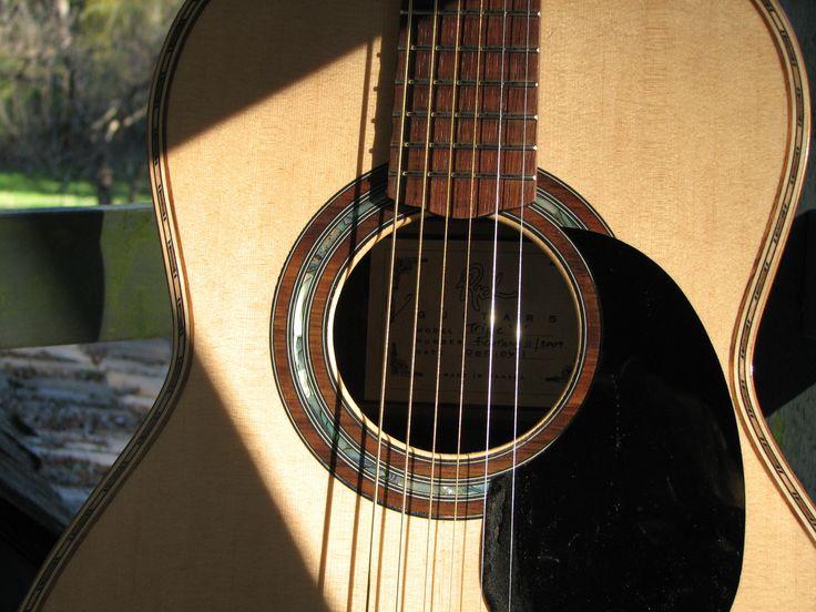 Detail of a Triple '0' guitar by Rich Guitars.