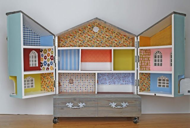 Beautiful DIY Doll House with drawer at the bottom for storage. Also love the casters on the bottom.