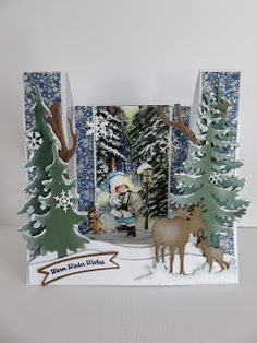 Card by Frosien with Creatables Tiny's Grass (LR0360), Elands (LR0377), Spar (LR0378), Den (LR0379), Craftables Tiny's Trees Oak (CR1338) and Punch Die Snowflakes (CR1336) by Marianne Design