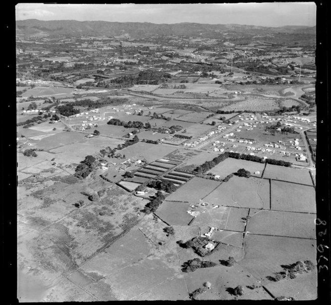 1955. Ramlea Park Estate subdivision (right) at Te Atatu Peninsula, Auckland. Showing the house built on the farm of John Thomas c1909, on what is now Barberry Lane. The Pedrotti family also owned the house. Hec E. Ramsey subdivided the land and developed sections along Taikata Rd, River Rd, Peachgrove and Yeovil Roads and Springbank Lane. Read more about this area and see a subdivision map in the book Te Atatu Me.