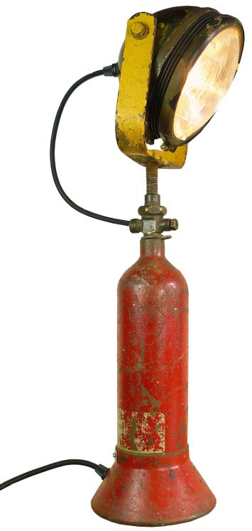 Old metal cylinder with headlight lamp (GU9) Switchable with rocker on the bottle. Industrial table lamp. Industriële Tafellamp van oude rode fles met oude koplamp