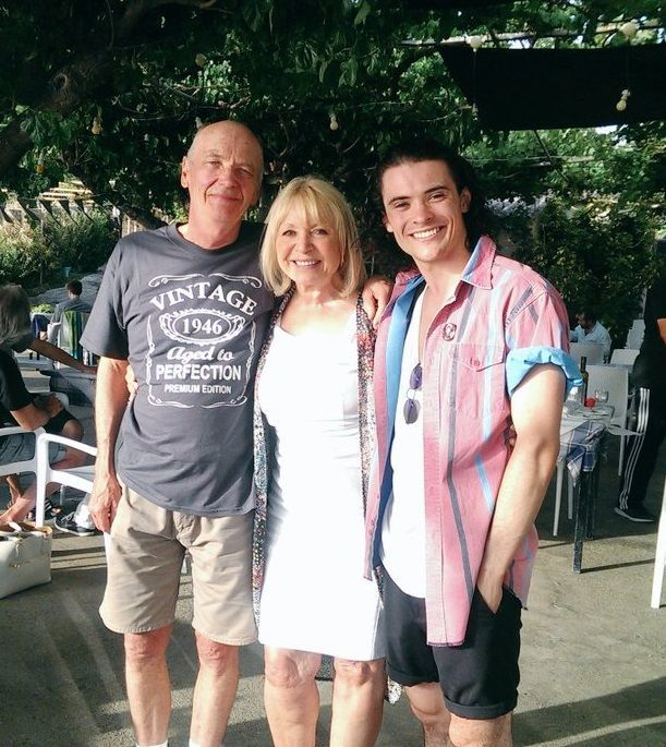 When you watch EastEnders four nights a week every week it's easy to fall into the trap of believing the people on your telly are actual real-life people.  Which is why we didn't really think twice when we saw a lovely family portrait of Les, Pam and Paul Coker on holiday in Greece on social media yesterday